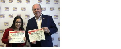 John Benoit with Public Service Recognition week sign.jpg