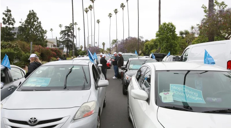 Uber and Lyft drivers take over Uber hub in solidarity with